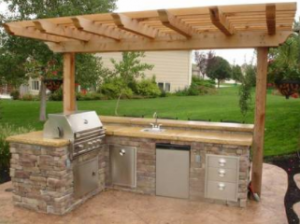 Raleigh hardscapes outdoor kitchen covered with a pergola