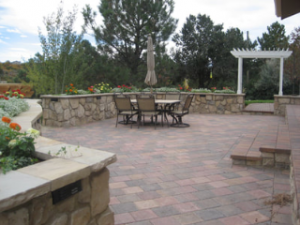 paver patio with retaining walls and beautiful landscape raleigh