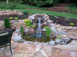 Raleigh hardscaping back yards water fall