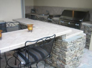 outdoor bar with bbq grill on patio