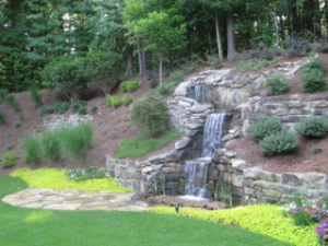 backyard waterfall coming down a hill in Raleigh